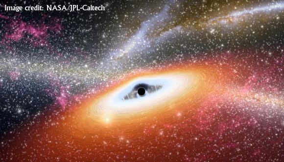 איור של דיסקת גז המזינה חור שחור מסיבי, תוך פליטת קרינה